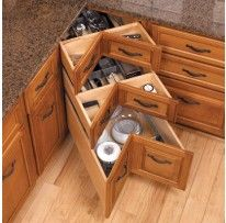 I am quite in love with this idea:  Blum Tandem Space Corner Slides.  I am currently in a hate relationship with my lazy susan corner cabinet.