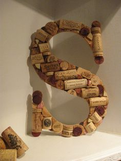 You may see this at my house someday soon.  Just need to figure out how to bind the corks together.
