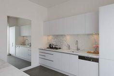 Cupboard doors - Freedom Kitchens. Iceland (White Satin Melamine) and Essence, Nocturne Oak Finish with Horizon Integrated Aluminium Handle