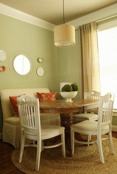 painted chairs and good use of a corner with a round table for extra seating. one bench instead of corner
