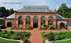 garden glass conservtories | Below the Walled Garden, the glass-roofed conservatory appears ...