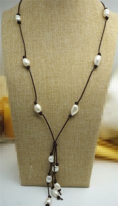 A personal favorite from my Etsy shop https://www.etsy.com/listing/221829759/long-freshwater-pearl-and-leather-lariat