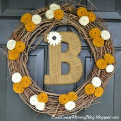Nice combination of a twine initial and a traditional wreath. These colors are perfect for fall, but I can see it being changed up too