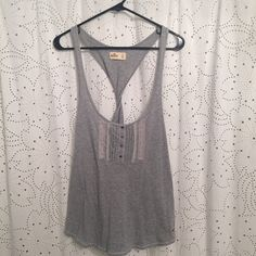Hollister twist back tank Gray Hollister tank, size L. Looks cute with a white bandeau underneath! The twist detail in the back is my favorite. Great condition, only worn once, if that. Hollister Tops Tank Tops