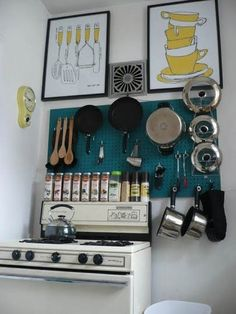 Organized (small) kitchen. love what was done with the pot lids
