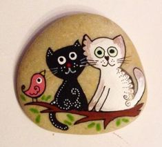 Cats and branch with bird painted rock