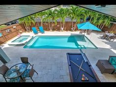 Backyard Pool And Spa, Pool Spa, Bradenton Beach, Island With Seating, Beach Bungalows, Cottage Style Homes, Outdoor Seating Areas, Stainless Appliances, Open Floor