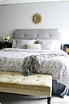 Tufted Upholstered Headboard  Love it all - the headboard, the grey colour scheme, the bench at the end of the bed...