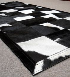 Black and White cowhide carpet  www.tapijtenenhuiden.com