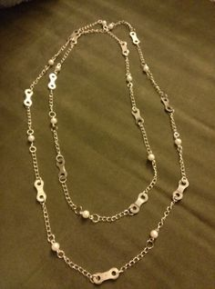 Long bike chain and faux pearl necklace, 50. No clasp, can be doubled. Bike chain links, sterling silver chain, and faux pearls.