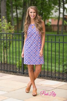 We adore the pattern on our Fall Into You Dress! It features coral and royal blue print for a fun and vibrant summer look! It also has a v-cutout in front and a keyhole cutout in back for a trendy touch!
