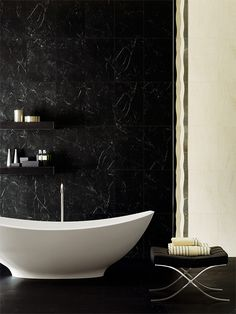 """Black bathroom tiles for wall and floor.  This is Nero Marquinia, ispired by dark natural stone interpreted through porcelain stoneware. The Cerim collection is called Le Pietre (""""Stones"""")."""