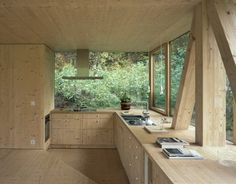 Zurich-based architect Pascal Flammer designed this timber house in Balsthal, Switzerland, which is sunken with ground-level wrap around windows, connecting it with nature in a special,. Timber House, Wooden House, Interior Architecture, Interior And Exterior, Contemporary Architecture, Kitchen Interior, Kitchen Design, Classical Architecture, Landscape Architecture