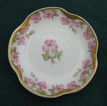 Antique Haviland Limoges Butter Pat  On A Heavy Gold Trimmed Scalloped Blank  This is a very special pattern of pink wild roses with green leaves and accents on a scalloped gold trimmed blank   $30.00