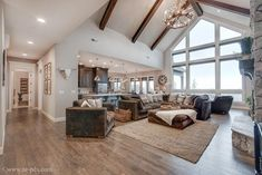 Mascord Design – Halstad > Quail Homes Grand room cathedral ceilings, wood beams, flooring. Move fireplace to window wall. Open flow to kitchen/eat-in space. Vaulted Living Rooms, Home Living Room, Living Room Designs, Living Room Floor Plans, Spacious Living Room, New House Plans, Dream House Plans, Lake House Plans, Dream Home Design