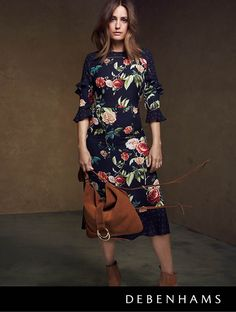Debenhams Autumn collection 2016 worn by Yasmin le Bon. This season femininity swirls into life as fashion falls for demure below-the-knee hemlines. Reimagined in autumnal florals and romantic pleats.
