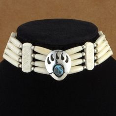 Bear Paw Bone Choker by Verna and Berlinda  This bone choker has a distinctive Native American Apache Indian design and is hand made with pipe bone, http://www.nativeamericanstuff.net/American%20Indian%20Chokers%20Breast%20plates,%20Bracelets%20&%20More.htm
