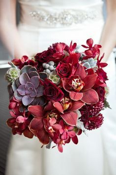 Your florist shouldn't have a hard time finding flowers to go with a Marsala theme! Use Marsala flowers either as accents in the wedding bouquet, or go bold with a full-colored bunch like this one. Red Bouquet Wedding, Floral Wedding, Wedding Colors, Wedding Flowers, Bridal Bouquets, Deep Red Wedding, Burgundy Wedding, Fall Wedding, Burgundy Bouquet