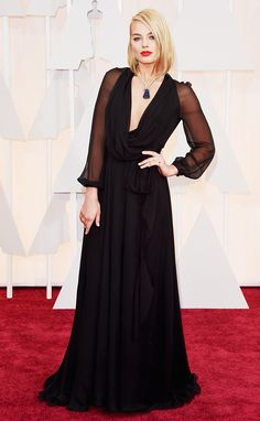Margot Robbie on the red carpet, wearing a black Saint Laurent gown and vintage Van Cleef & Arpels necklace - Oscars 2015. Celebrity style   gowns   Academy Awards