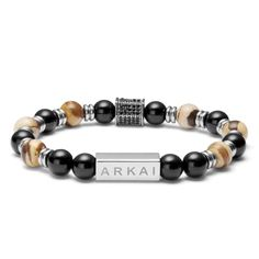 * One-size-fits-most stretch bracelet * Danish design * Black Onyx and European agate stone * Silver-tone stainless steel accents * Luxury gift pouch and box included Pearl Bracelet, Stretch Bracelets, Bracelets For Men, Paracord Bracelets, Beaded Bracelets, White Shoes Men, Bracelet Cuir, Square Rings, Bracelets