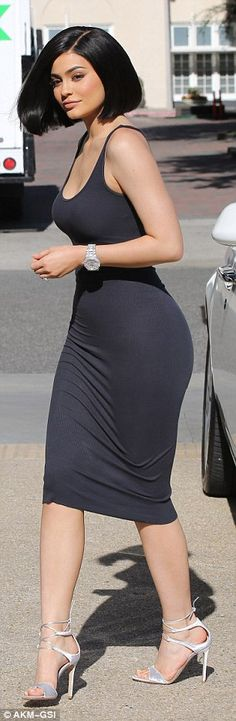 Dangerous curves ahead! Jenner donned an extremely tight dress during a spot of shopping i...