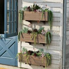 DIY PLANTERS :: Neat Way To Use Window Boxes :: Smith & Hawken's website (products available @ Target) has great ideas for inspiration, like this one. Wooden windowboxes can be mounted on a wall with SHELVING BRACKETS to take advantage of vertical space-- perfect for balcony and patio gardeners that are short on space! | #windowboxes