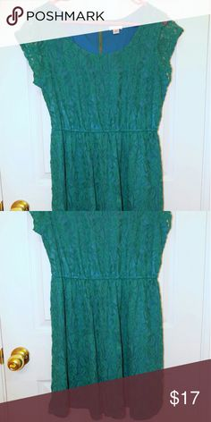 Turquoise Lace Dress Only worn once! Great condition! Beautiful blue dress with turquoise/green lace on top. Cute gold zipper in the back. Stretchy waistband. Purchased from Target. -Shell : 66% Cotton 34% Nylon -Lining : 100% Polyester Xhilaration Dresses Mini