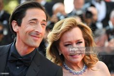 US actor Adrien Brody and the Co-President of Chopard Caroline Scheufele arrive on May 28, 2017 for the closing ceremony of the 70th edition of the Cannes Film Festival in Cannes, southern France. / AFP PHOTO / Anne-Christine POUJOULAT