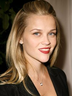 Growing out your hair? Reese Witherspoon demonstrates a cute style for tucking away bangs.
