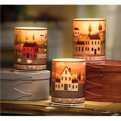 beautiful flamless candles. Homemade version: Glassware from hobby lobby, craft or scrapbook paper, & deco glue (it dries clear and seemless), add candle and tada!
