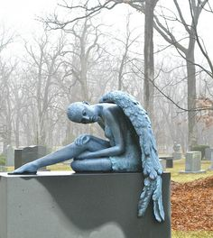 Mourning angel...looks like her wings are weighing her down at the moment with grief.