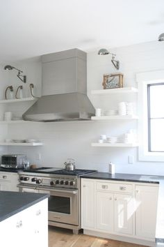 Stainless Floating Shelves Amazing Kitchen Features Stainless Steel Range Hood Flanked