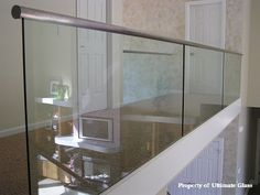Ultimate Glass & Mirror Inc. Specializing in custom glass work and bath enclosures since 1981