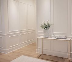 Neutral decor, foyer, entryway, benjamin moore simply white, wisteria console table.