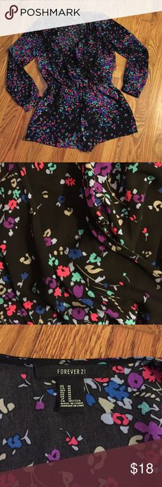 Floral v neck romper This is a floral print V neck romper from forever21.. Long sleeve & shorts with a snap close on the bust area. Forever 21 Pants Jumpsuits & Rompers