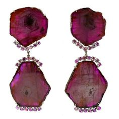 Genuine Ruby Slice Gold Earrings. Stunning one-of-a-kind Drop Earrings featuring Natural Ruby Slices inter-spaced with genuine Rubies; set in handmade 14k white gold mountings; slices weighing approx. 150ct. and forty round rubies, weighing approx. 5ct. approx. length: 3 inches.