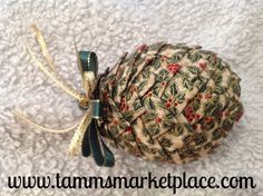 "This pine cone ornament is made from many tiny swatches of ribbon folded and pinned into a 4"" craft Styrofoam egg and then topped with more ribbon to create the loop that it hangs from. Very beautiful"