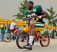 FLAT TIRES Green Bay Packers Ryan McMahon rides a bike to NFL football training camp Tuesday, July 30, 2013, in Green Bay, Wis. (AP Photo/Morry Gash) MORE NFL TRAINING CAMP PHOTOS HERE