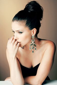 sophia, her bun and earrings