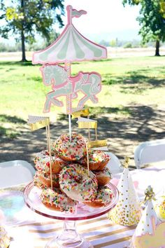 Sprinkle donuts at a carousel birthday party! See more party ideas at CatchMyParty.com!