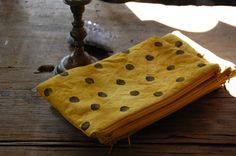 dot zip pouch in saffron  made in small dye lots with some variation in dye color and markings  all natural and foraged dye materials used  organic