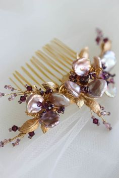 We handcrafted this purple orchid wedding comb for Audrey to complement her bridal, hand-painted cheongasm, using freshwater pearls and Swarovski crystals.