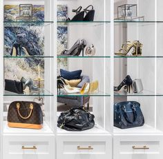 An accessory-filled centerpiece creates order for handbags and shoes in this dazzling dressing room design. #californiaclosets