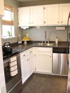 slate floors, gray walls, white cabinets, stainless & black appliances... this sould be our kitchen!