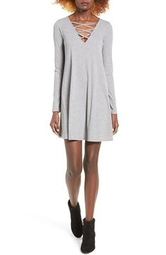 Free shipping and returns on Love, Fire Long Sleeve Rib Knit Dress at Nordstrom.com. Skinny straps crisscross over the V-neckline on this swingy, long-sleeve dress made from a cozy rib knit with a dose of stretch.