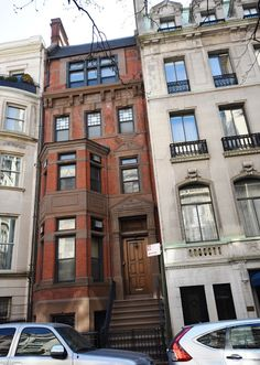 8 East 67th Street, brownstone-fronted row house designed by architect James E. Ware in the Queen Anne style and completed in 1881. Four stories tall over a high English basement with decorative panels, stained glass, bays & dormers that defined the style.
