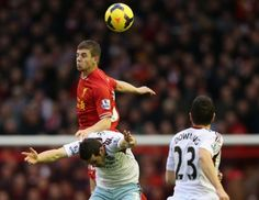 Jon Flanagan out jumps Matt Jarvis as former red Stewart Downing looks on