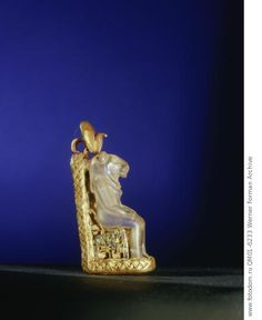 Quartz amulet of the lion-headed goddess Bastet seated on a gold throne. From the tomb of Wen-djeba-en-djed, senior official of Psusennes I. Country of Origin: Egypt. Culture: Ancient Egyptian. Date/Period: 21st Dynasty, 1039 - 991 BC. Place of Origin: Tanis. Material Size: Gold, paste, quartz