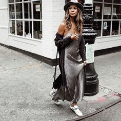 Take your slip dress into winter with a long cardigan, sneakers and fedora hat
