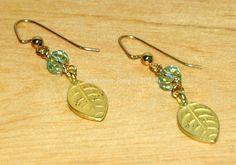 Gold Leaf and Pale Peridot Swarovski Earrings by SeasonsJewels on Etsy